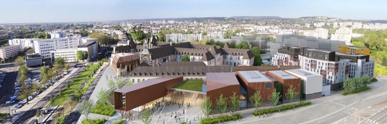 Vue aérienne du projet de la future Cité de la Gastronomie et du Vin de Dijon : tout à gauche, le parking de surface où a été construit le parking silo destiné aux visiteurs et tout à droite, les logements sociaux aujourd'hui en construction. ©Anthony Béc