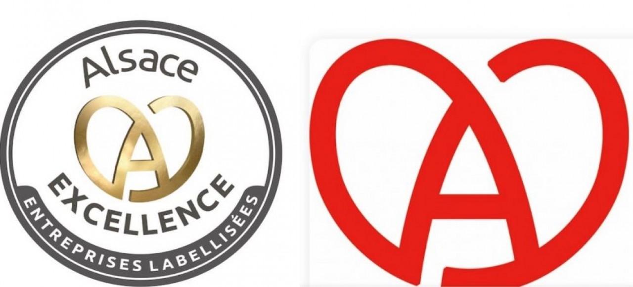 Le nouveau logo du label «Alsace Excellence» ( à gauche) abandonne le rouge commun avec la marque Alsace (à droite) pour se parer d'or, et éviter la confusion, même si les deux incarnent la même attache territoriale. ©Adira