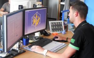 Préparation d'une maquette numérique pour le rangement de pièces de carrosserie automobile.  ©Christian Robischon.